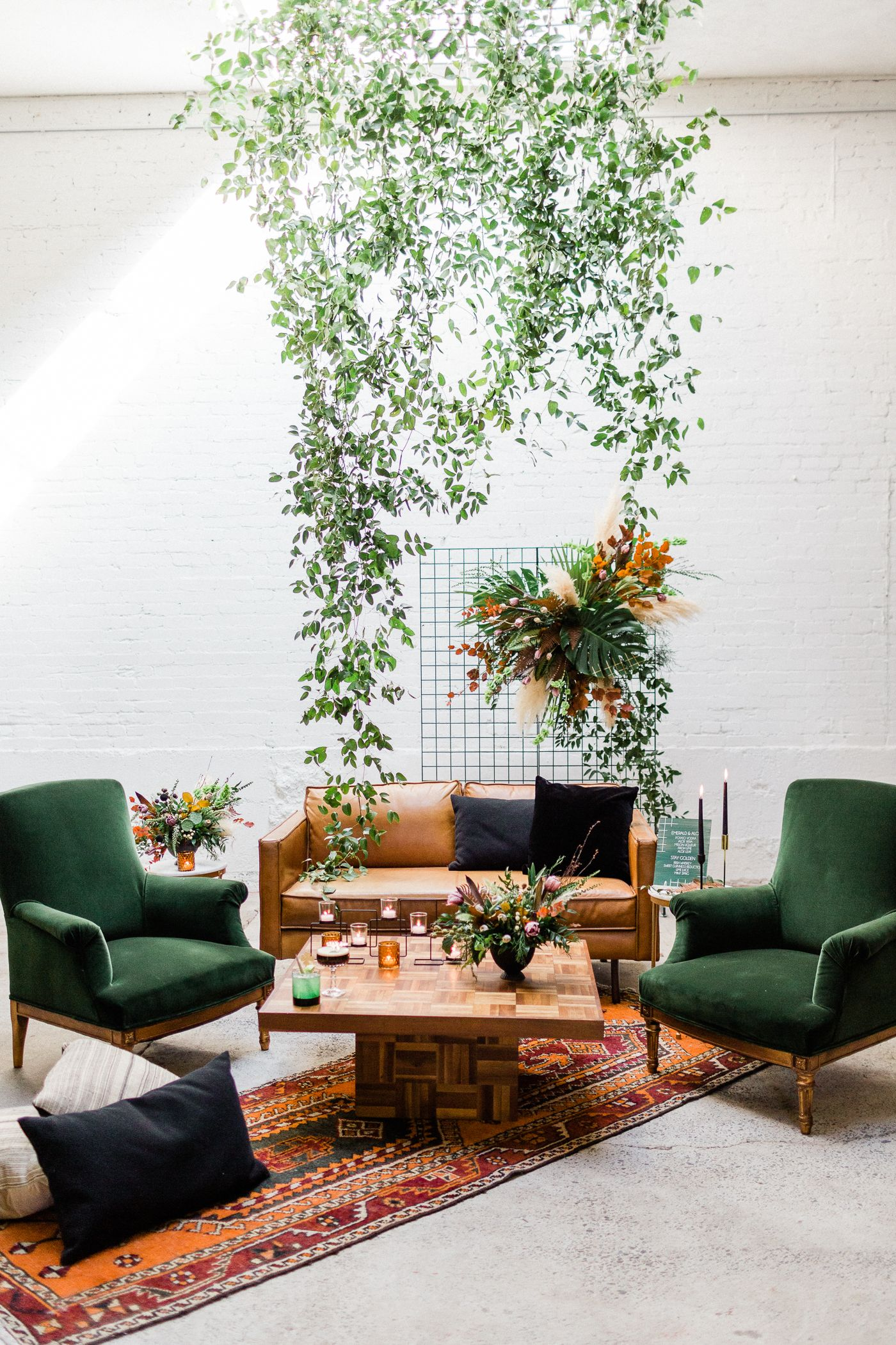 Event lounge inspiration with green velvet chairs, leather