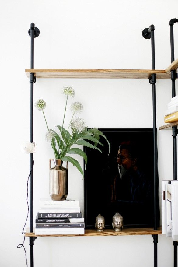 Home Tour: A Perfectly Balanced Creative Seattle Pad// Industrial wood and pipe bookshelves