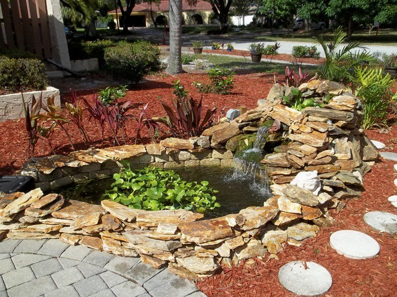 Small koi pond mulch waterfall awesome home design for Small koi pond