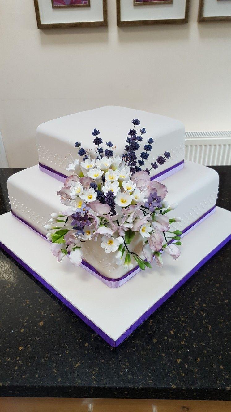 Lavender freesias sweetpeas square 2 tier wedding cake