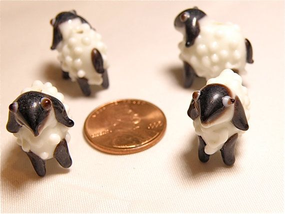Four (4) white and dark brown woolly sheep or lamb beads.  Sizes vary slightly, but approximate measurements are 23 mm in length; 19 mm tall, and 12 mm wide. Hole is approximately 1.5 to 2 mm in diameter.  Because these are handmade, you can expect variations in size, shape, and design.