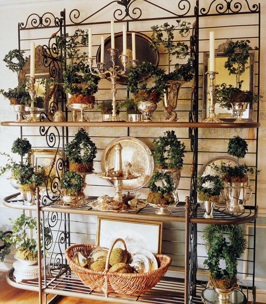A Baker S Rack Filled With Silver And Topiaries Creates A Glorious