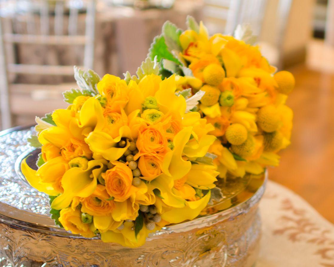 Yellow callas and ranunculus.