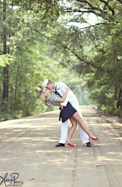 """Reminds me of that old photograph """"The Kiss"""". This could also be a cute idea for army or air force - finding a vintage uniform for the groom/male and then doing a pin-up vintagey look on the bride/female."""