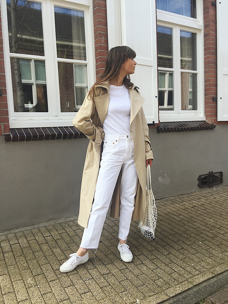 Spring streetwear inspiration all white trenchcoat urban style