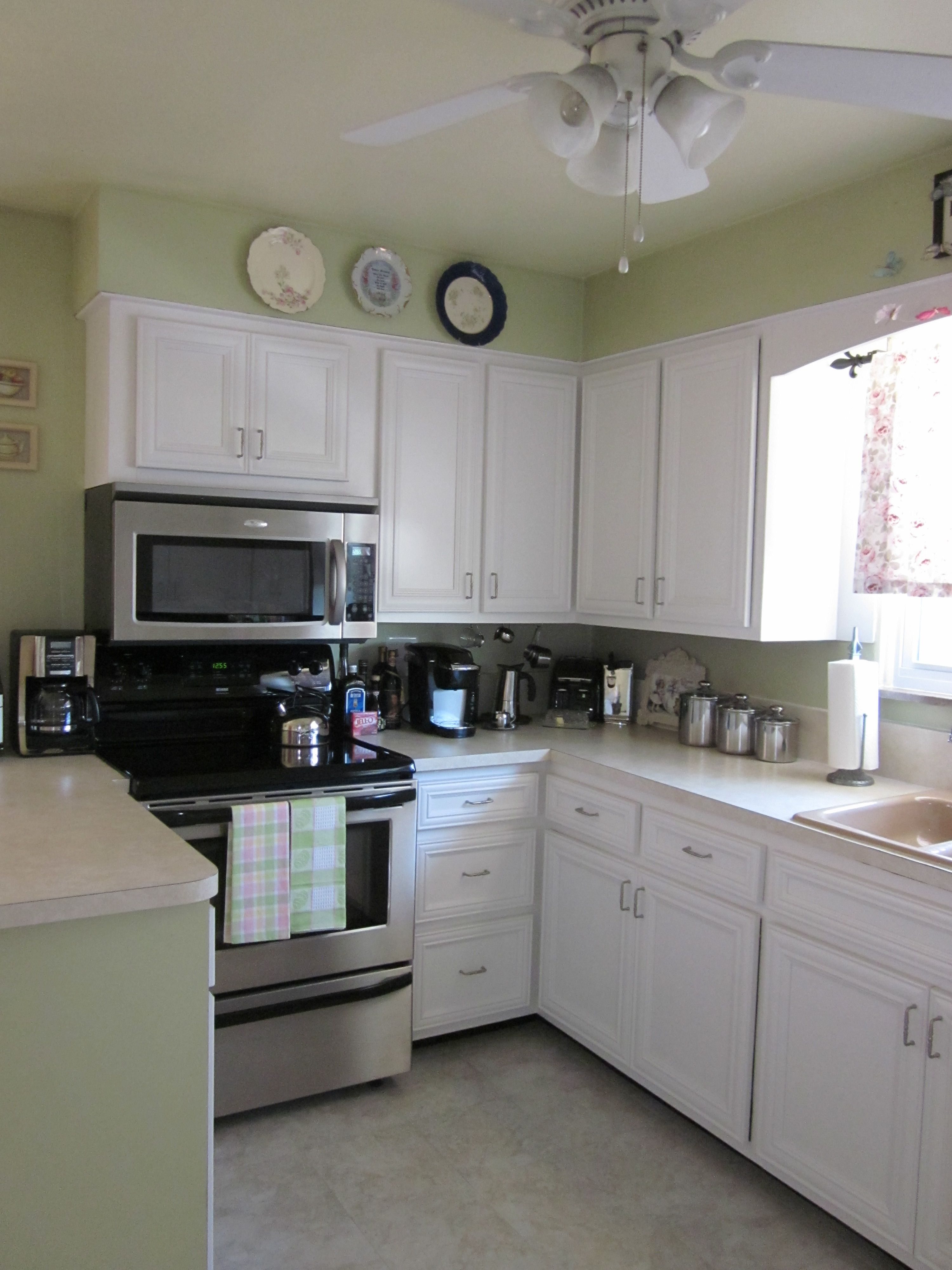 Refaced kitchen cabinets love the trim on them | Pantry ...