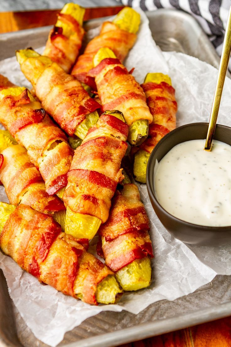Bacon Wrapped Pickles -- These oven baked bacon wrapped pickle spears (aka pickle fries) are the perfect double-duty, easy appetizer for any gathering... Keto-friendly for your low carb guests, but still tasty enough to appeal to everyone else, and just 2 ingredients! | pickles wrapped in bacon | pickle fries recipe | bacon wrapped pickles recipe