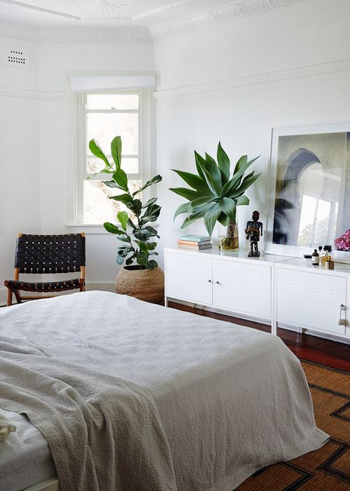 White Bedroom With Mid Century Black Woven Chair And Plants Via Thouswellblog