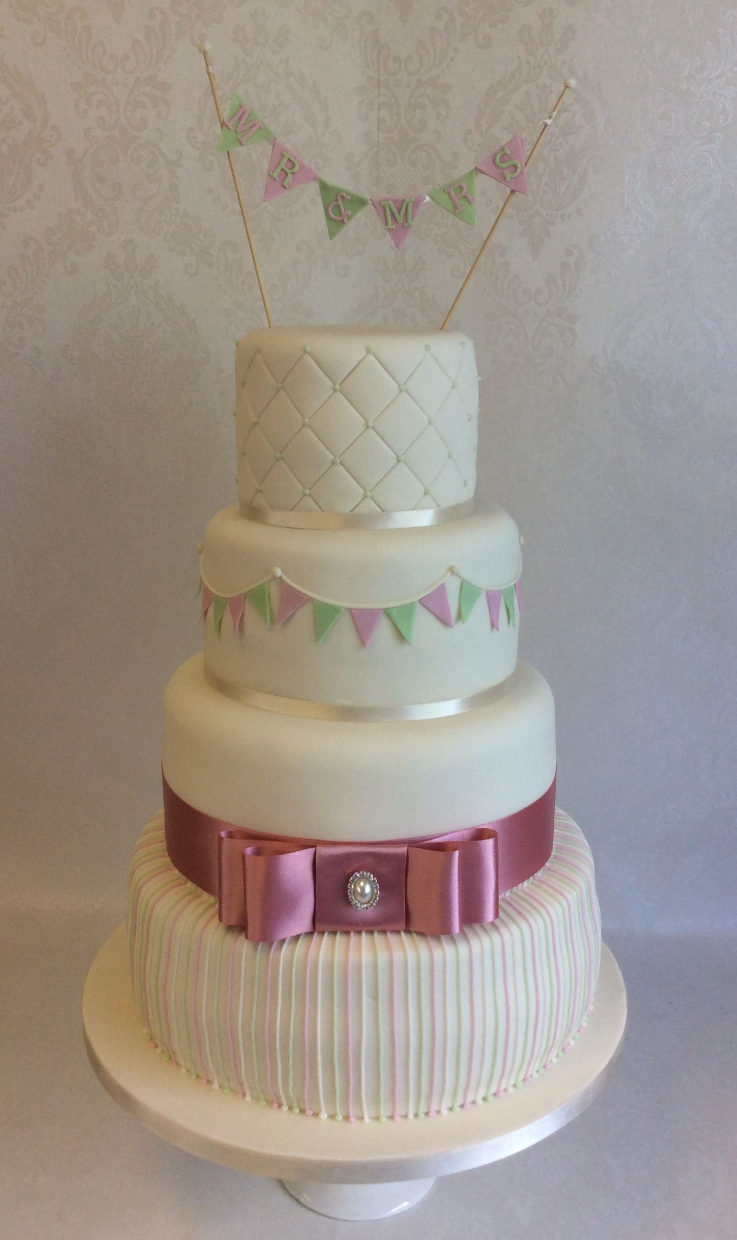Alice - in dusky pink and pale green with bunting inkeeping with the decor at the wedding