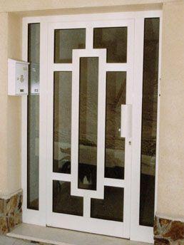 Puerta de entrada de aluminio y vidrio adri na for Vidrios para puertas principales
