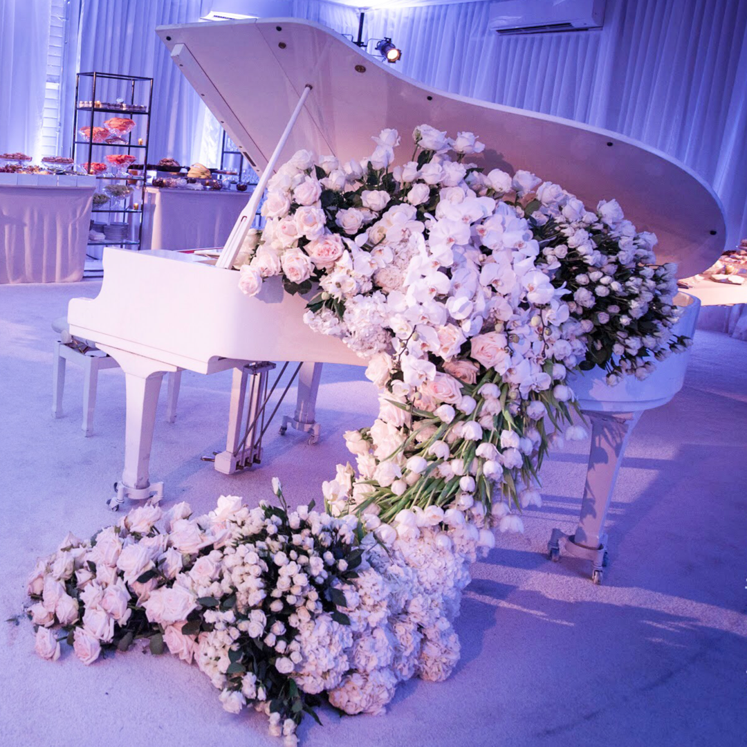 Ivories And White Florals Coming Down From A Grand Piano