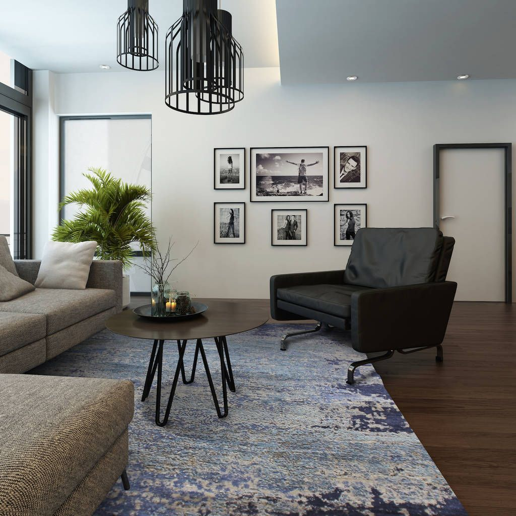 Abstract blue rug in this stylishly modern living room. | The Rug