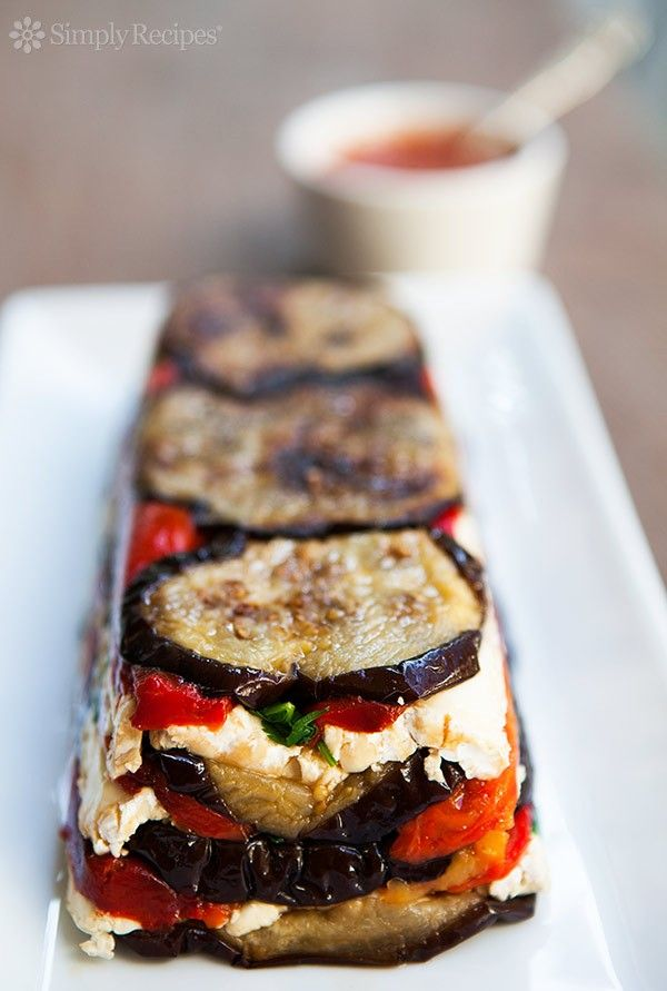 Eggplant and Red Pepper Terrine ~ Eggplant and roasted red pepper terrine recipe, with sliced eggplant, roasted red bell peppers, parsley, Brie or Mozzarella, in a fresh tomato sauce. ~ SimplyRecipes.com