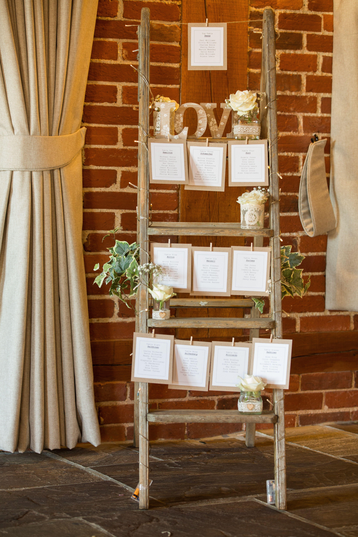 Rustic wooden ladder table plan kent wedding venue