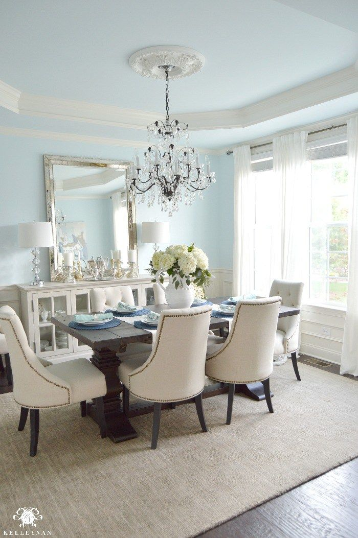 Horizontal Buffet Mirror Crystal Chandelier In Elegant Blue Dining Room With Restoration Hardware Trestle Table And World Market Linen Lydia Chairs Ikea