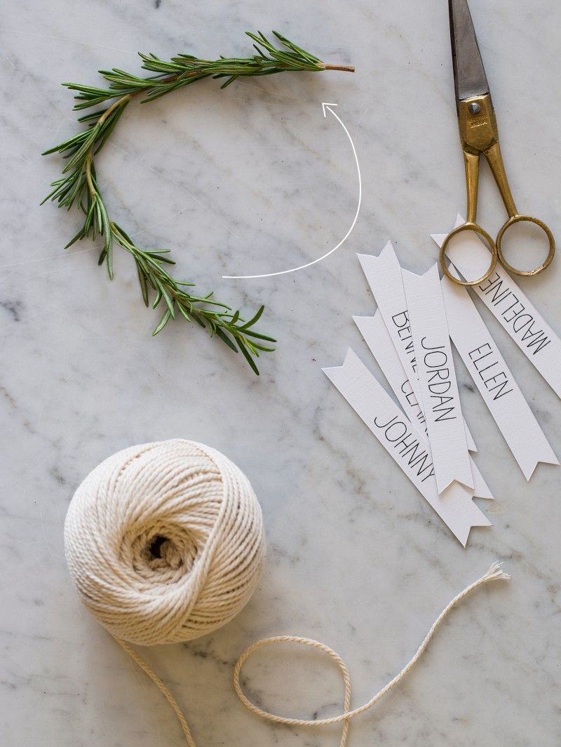 DIY Rosemary Wreath Place Cards tutorial from @spoonforkbacon - This project is really simple. All you need are rosemary sprigs, floral wire, scissors, and twine.