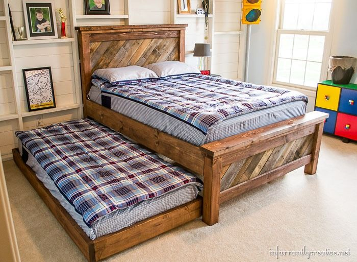 diy farmhouse pallet bed u2013 with a rolling trundle this diy project comes with a