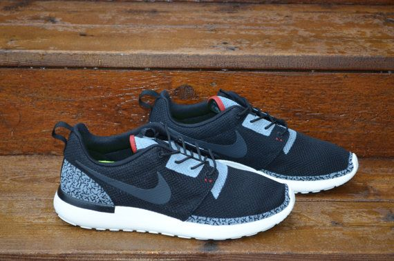 aliexpress for sale is a pair of custom nike roshe run black cement  inspired by the 83aed564b