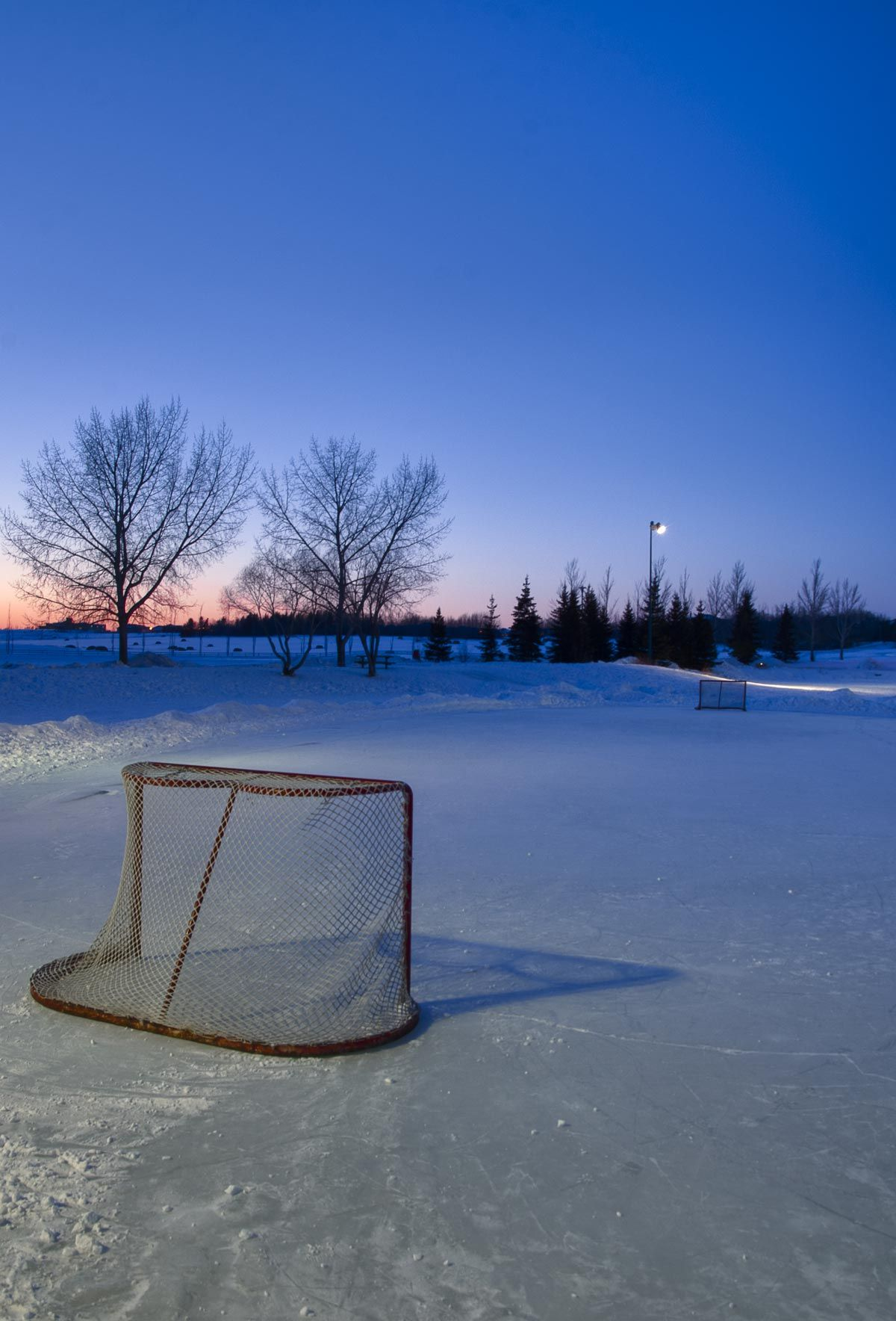 Sunset With Vacant Pond Hockey Rink By Darcy Michaelchuk Hockey Hockey Rink Hockey Arena