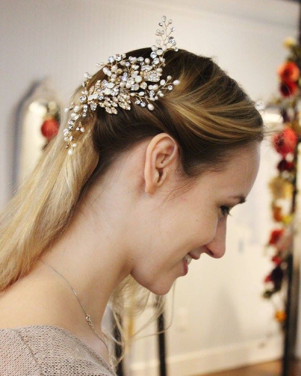 This loveliness was captured during one of our appointments this past Saturday! We are in love with this Crystal and Opal Spray comb by Twigs and Honey! It is the perfect touch of sparkle for your wedding day! Thank you for being a hair model @meg.lindsay !  #villagebridal #twigsandhoney #birminghambride #alabamaweddings #bridalaccessories