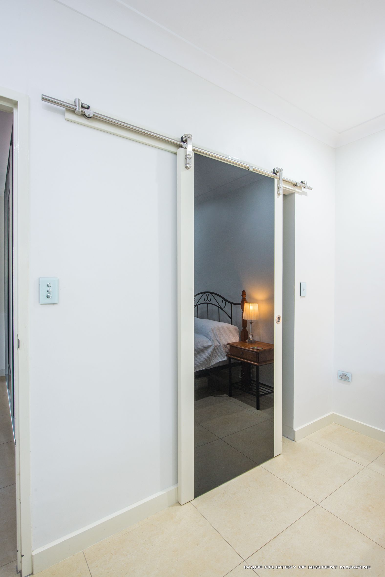 In This Top Hung Sliding Door We Used Black Glass And Painted The Timber Sides White To Match The Walls Modern Barn Door Sliding Doors Modern