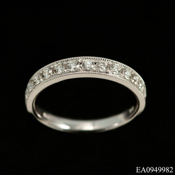 This impressive diamond set wedding band half eternity ring