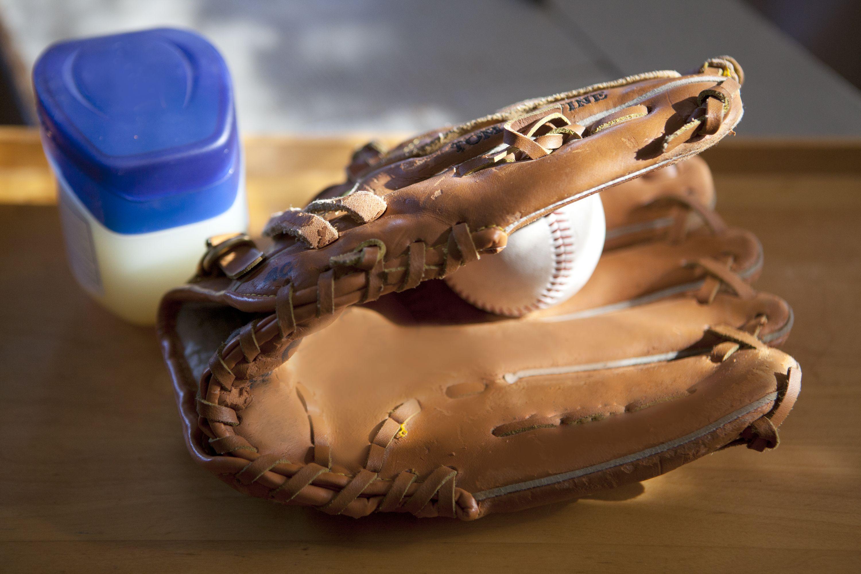 How To Break In A Baseball Glove Using Vaseline Break In Baseball Glove Baseball Glove Baseball Equipment
