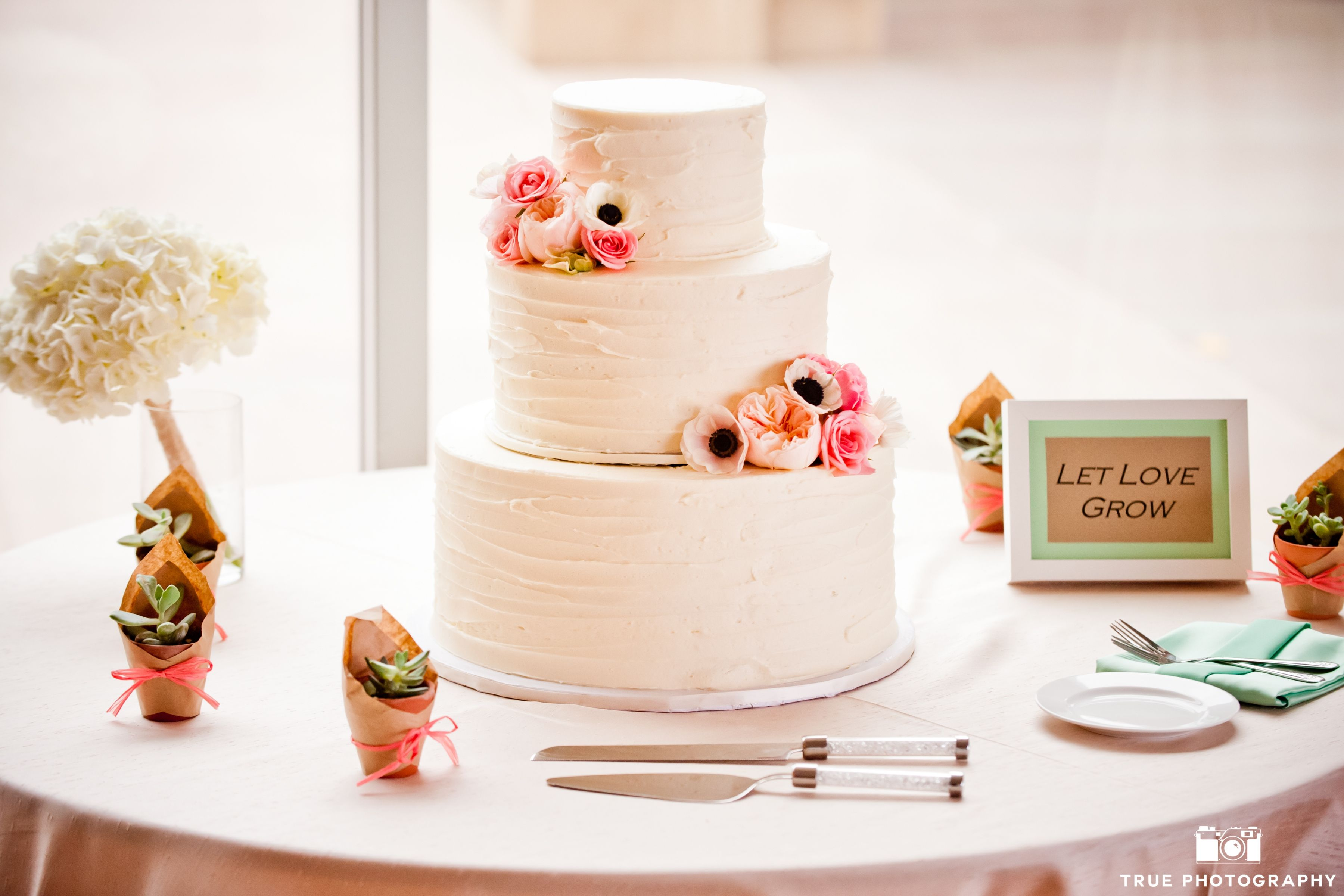 Perfect pink and white wedding cake with added peonies and