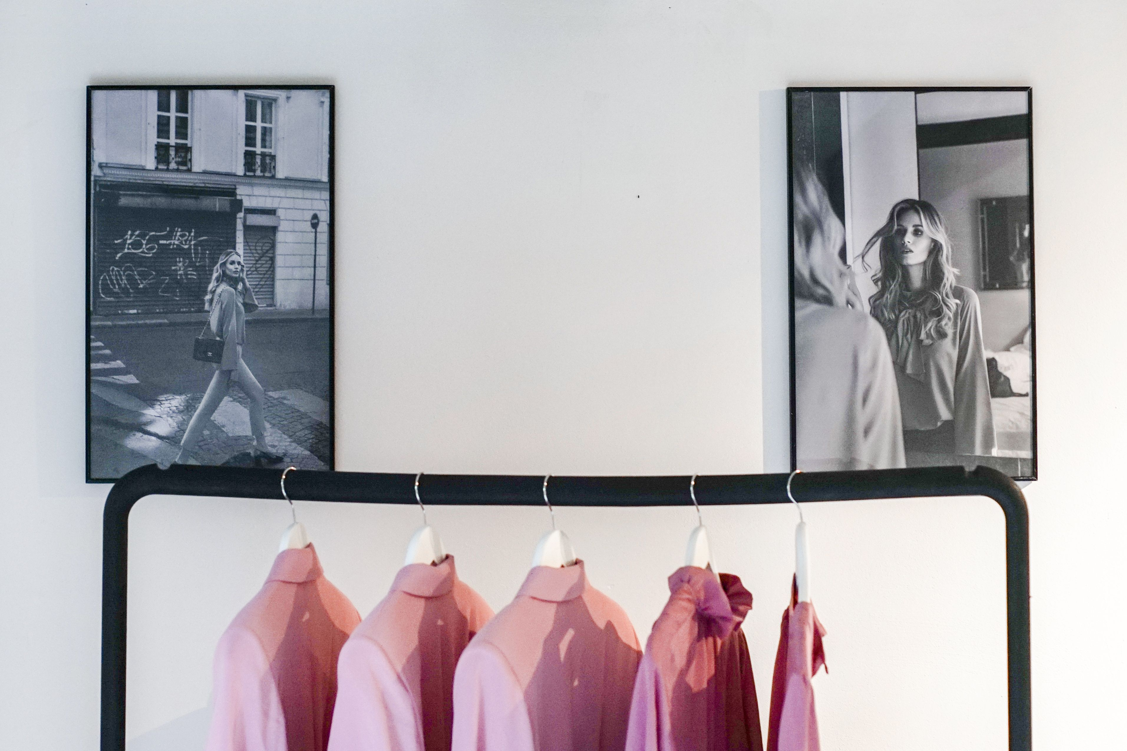 Clothing rack with pictures of the shoot in paris daylliance