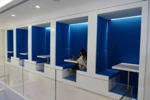 Booths offer a little privacy, a little comfort, and a lot of Mashable blue.