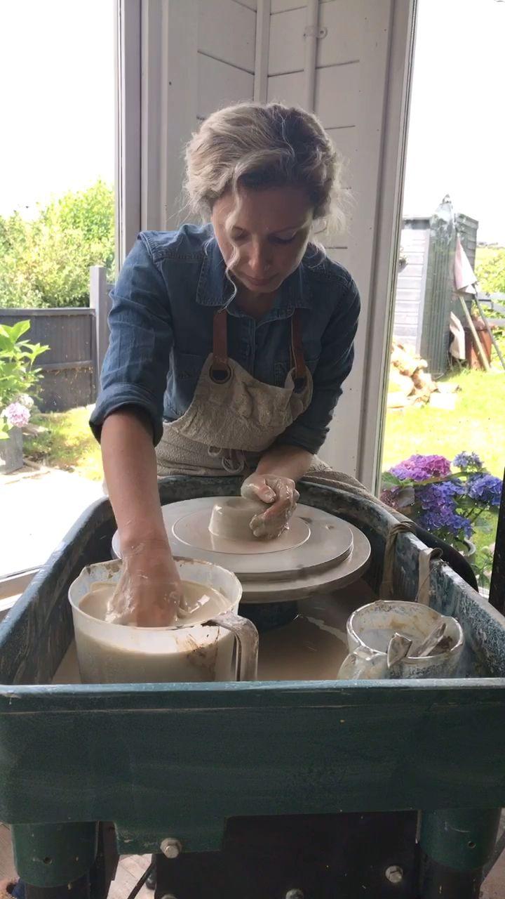 Throwing a mug on the potter's wheel
