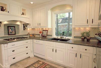 White Kitchen Cabinet Design Ideas dark grey counter looks good with darker knobs and my white