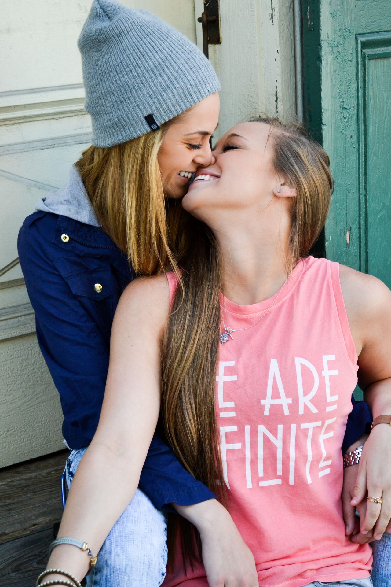 Two asian girl teen love together looking together and smile stock image