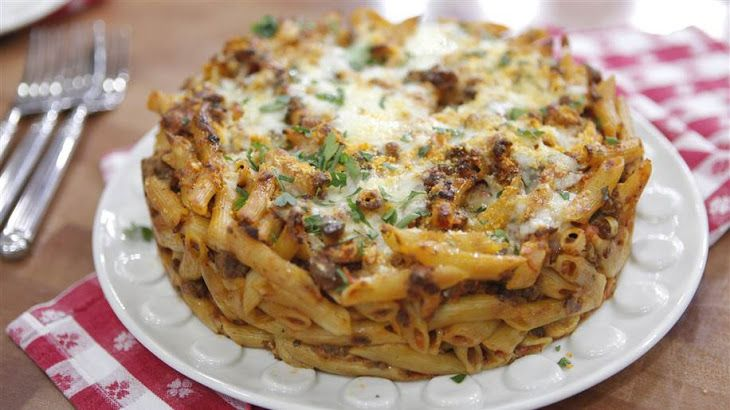 Penne Pie Recipe Main Dishes with penne pasta, ground beef, olive oil, yellow onion, large eggs, marinara sauce, whole milk ricotta cheese, grated parmesan cheese, flat leaf parsley, shredded mozzarella cheese, salt, freshly ground black pepper