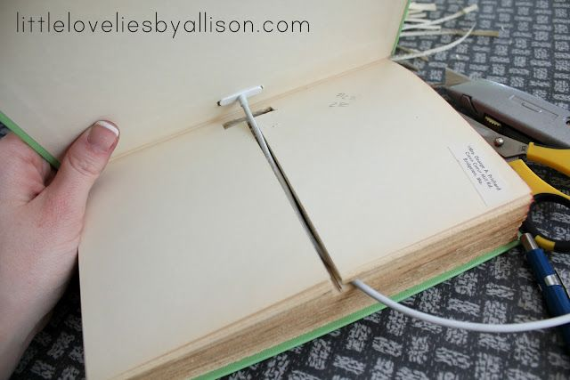 DIY iphone charging dock made out of vintage books! Nightstand gem, vintage, amazing.