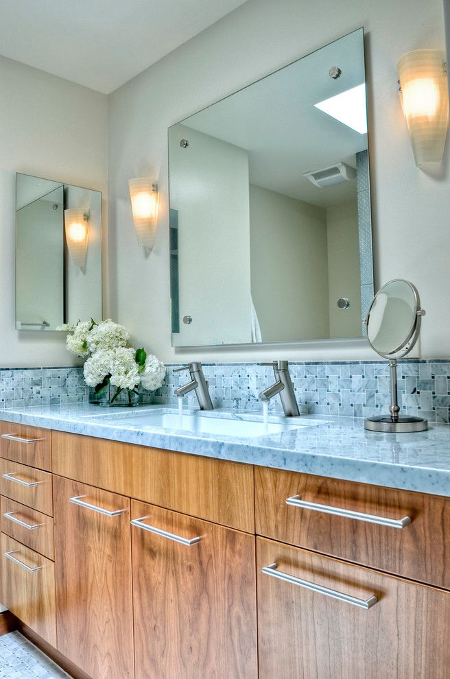 Carrera Marble Bathrooms Basket Weave Backsplash Mirrors Wall Lamps Wide Sink Double Faucets Wooden Cabinets Blue Countertop Traditional Design Of Fabulous