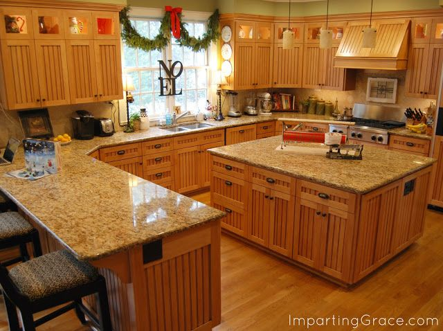 Golden Oak Kitchen Cabinets And Wood Floor The Are A Little Busy With Too Many Boards Trim Is Wide But Overall Concept