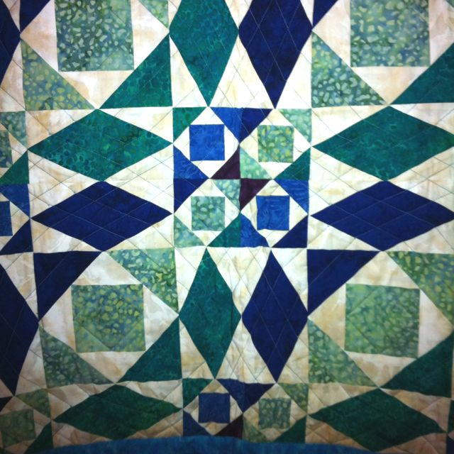 Our quilt- made by my very own mom!  <3