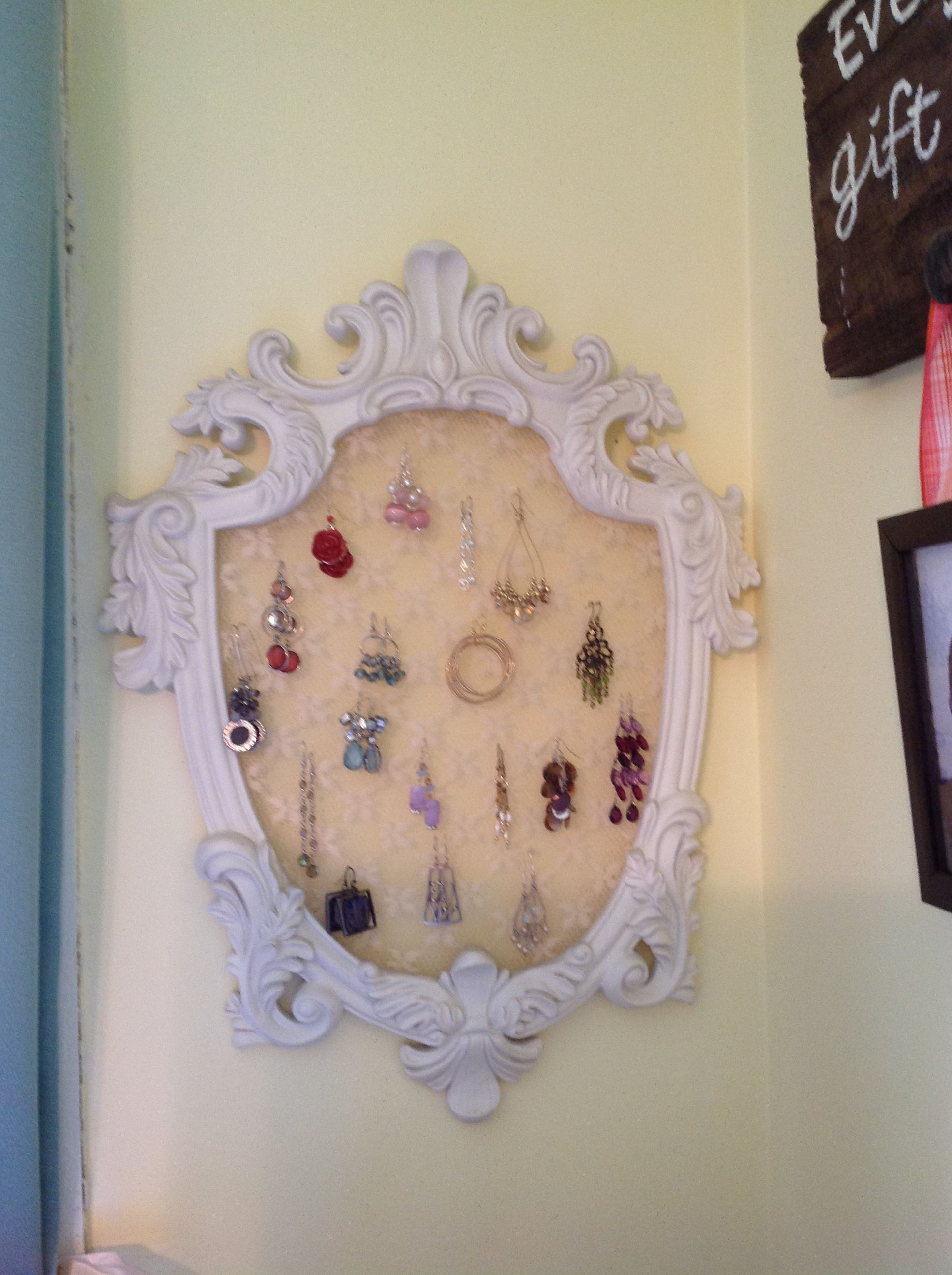 Old mirror frame, hot glue, and lace...earring organization!