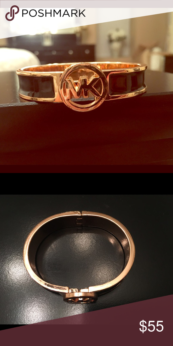 Michael Kors Large Label Bracelet In good condition. Only worn a couple of times.  Black and rose gold. Michael Kors Jewelry Bracelets