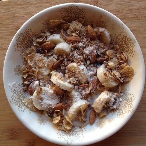 banana coconut cereal [sliced bananas coated in coconut flour] + granola . sprouted whole grain flaked cereal . cinnamon . vanilla . hazelnuts . almonds . coconut milk.