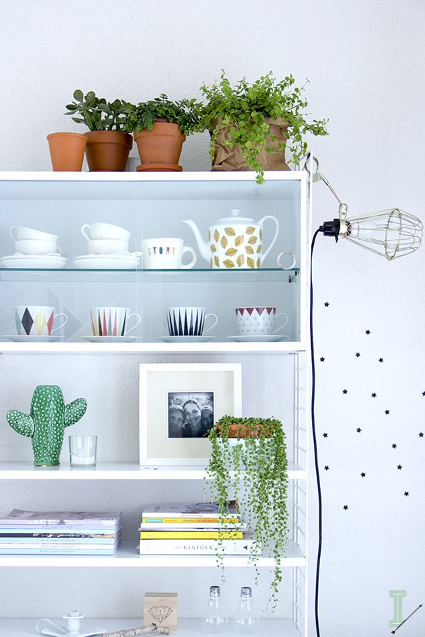 string shelf + glass cabinet styling w/ magazines, cute tea cups & plants | #home decor