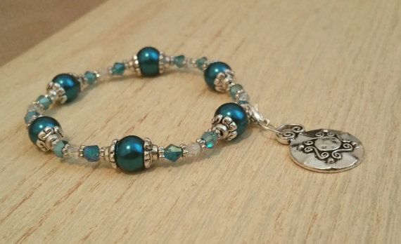 Check out this item in my Etsy shop https://www.etsy.com/listing/236435972/peacock-blue-beaded-bracelet-with