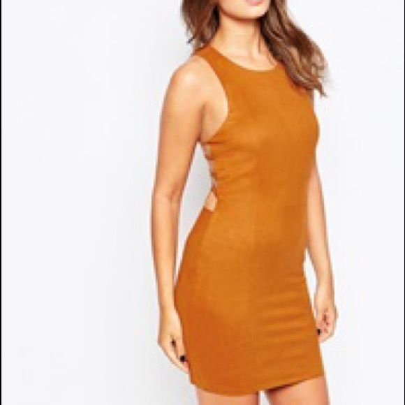 NWT Club L suedette bodycon dress with caged back NWT Super sexy faux suede bodycon tank dress by Club L with an open caged back. Dress it up or down! Euro size 10 / US size 6 Club L Dresses Mini