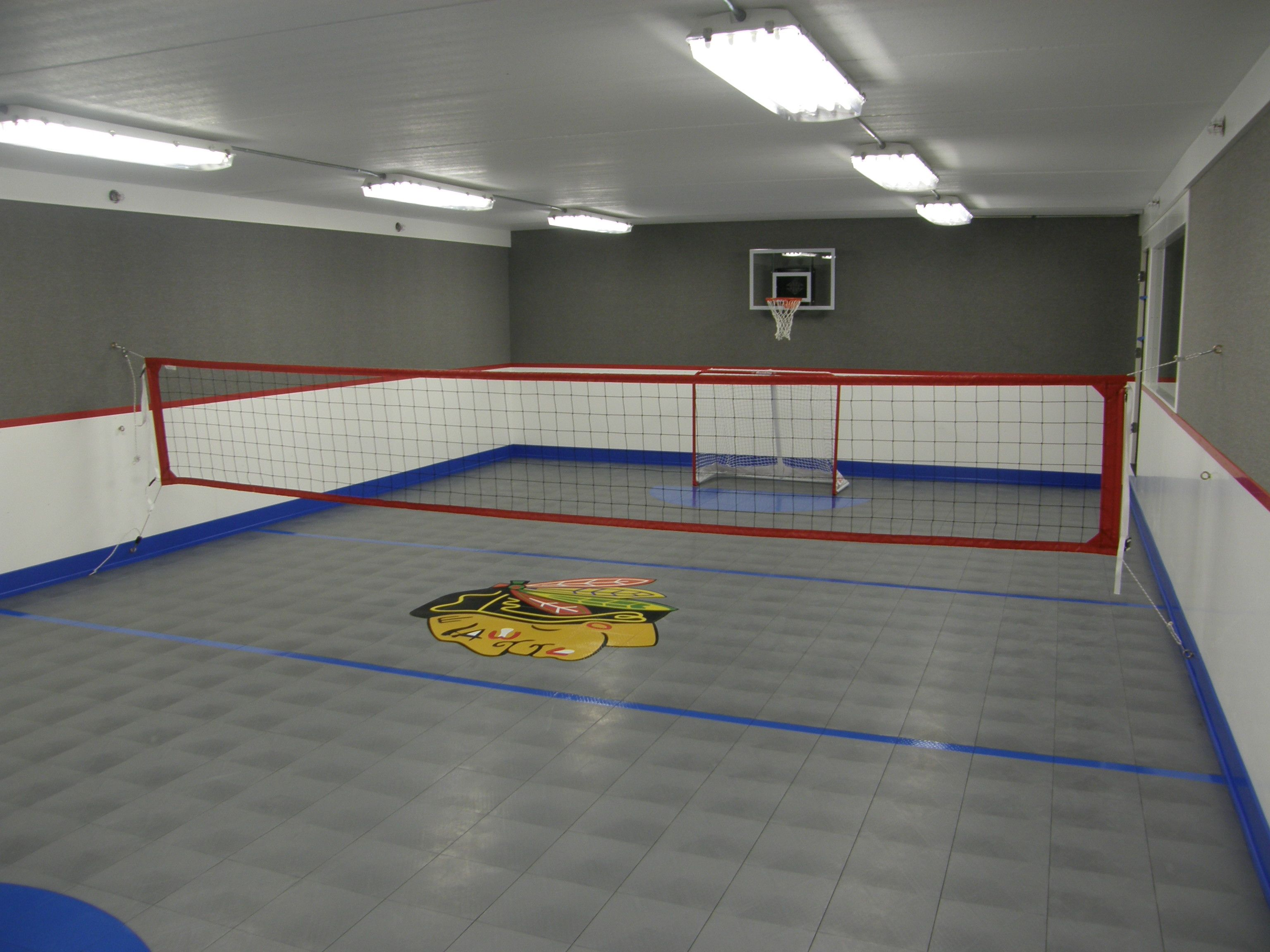 Want A Place To Play Sports In Your Home This Sport Court Multi Sport System Allows Your Family To Play I Home Basketball Court Indoor Sports Court Indoor Gym