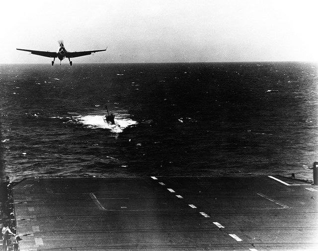 A Tbm Avenger Landing While The Carrier Was Towing The Captured German Submarine U 505  The Escort Carrier Kept Up Flight Operations For Days