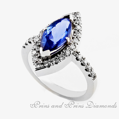Centre stone is a 2.14ct  bV/EC marquise cut tanzanite with a halo of round brilliant cut diamonds and side stones equalling 0.34ct GH/VS – SI
