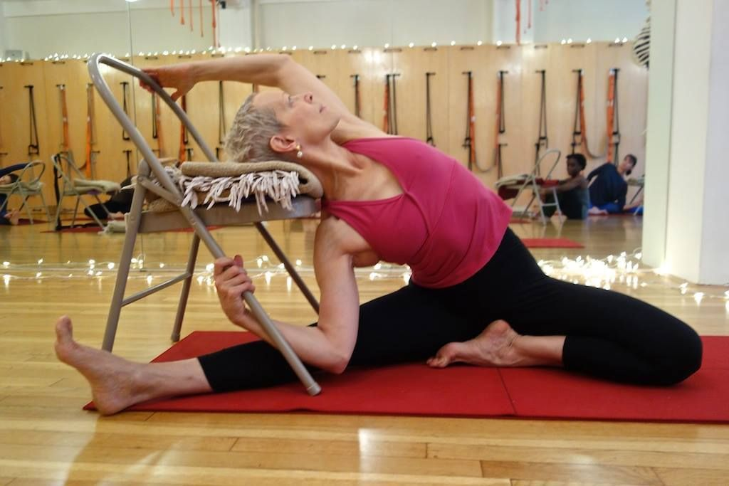 Parivrtta janu sirsasana iyengar yoga chair twists for Chaise yoga iyengar