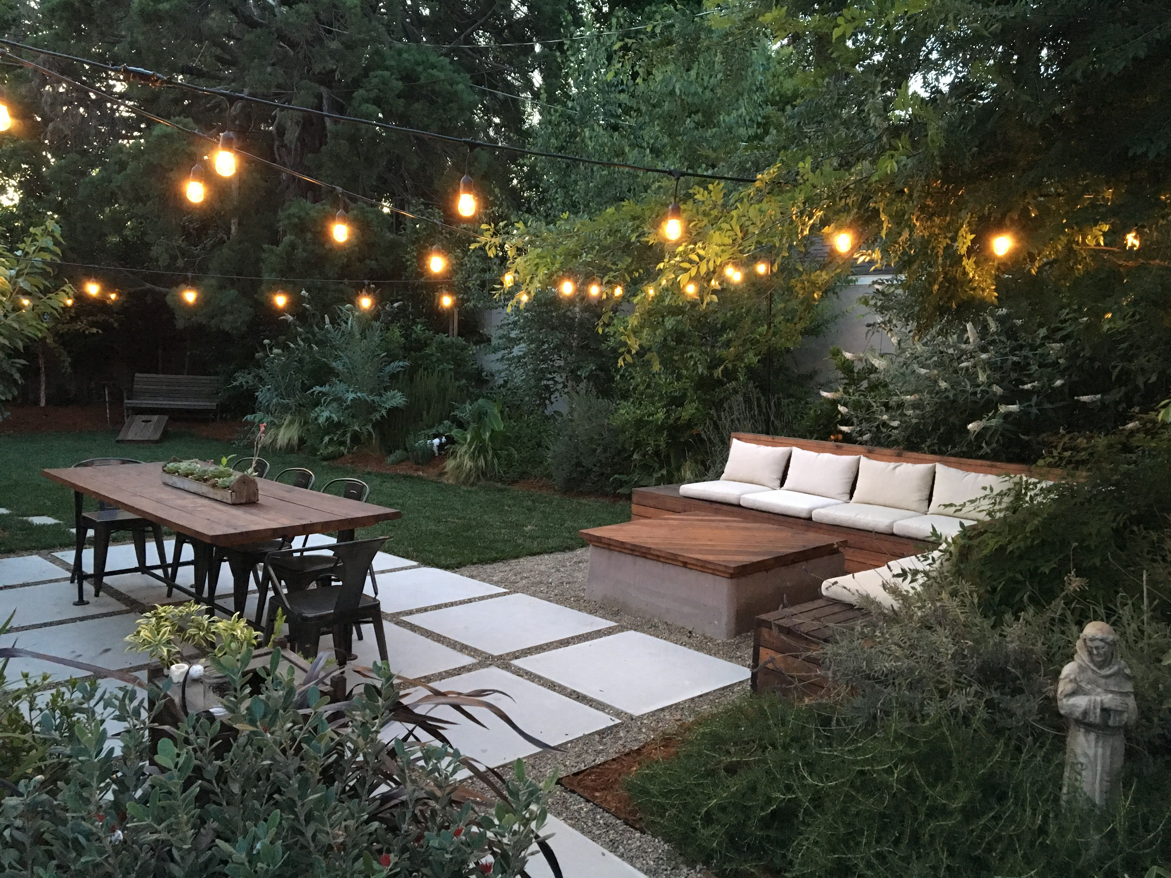 Our Backyard Patio Design And Outdoor Sectional Seating Area With Cafe Lights Incorporates An Open F Backyard Seating Area Backyard Dining Backyard Renovations