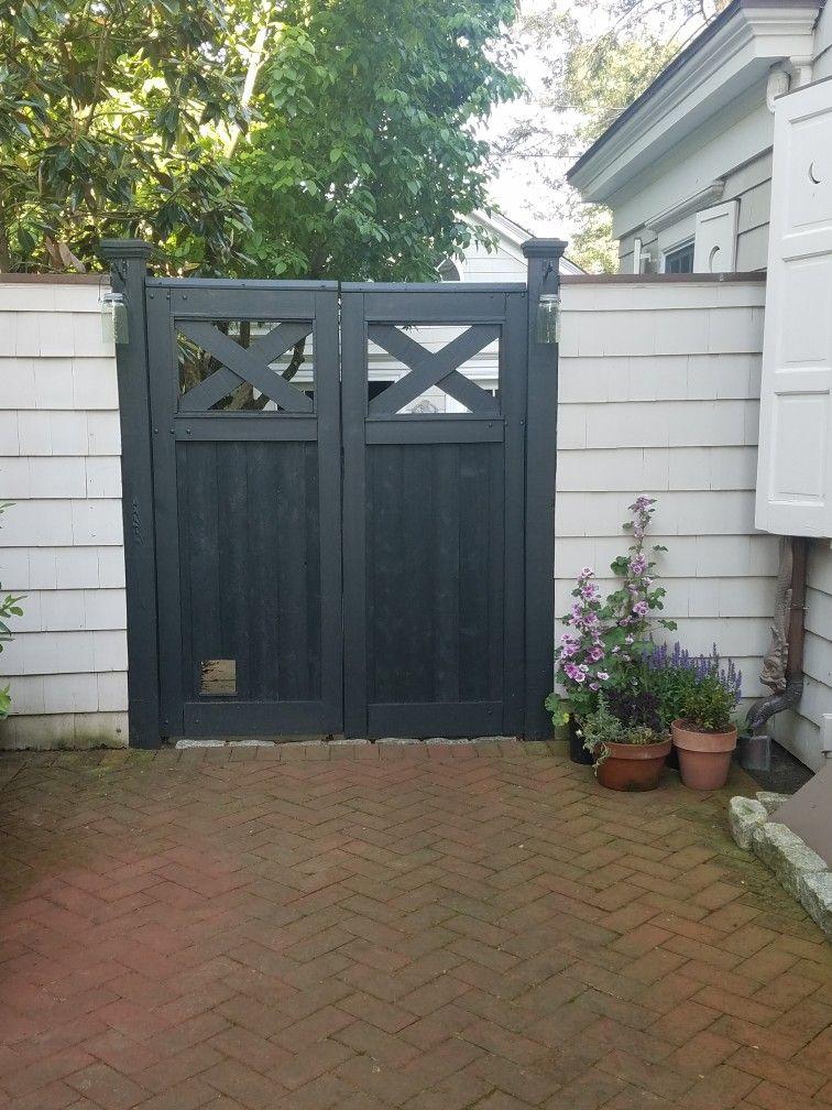 driveway gate with cat door animal